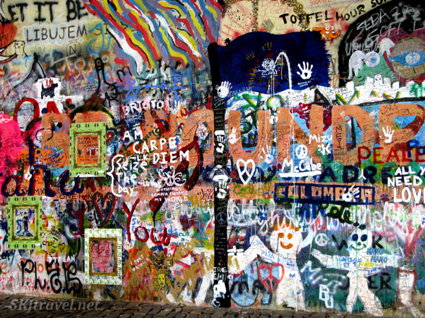 Dense graffiti on the John Lennon wall in Prague.