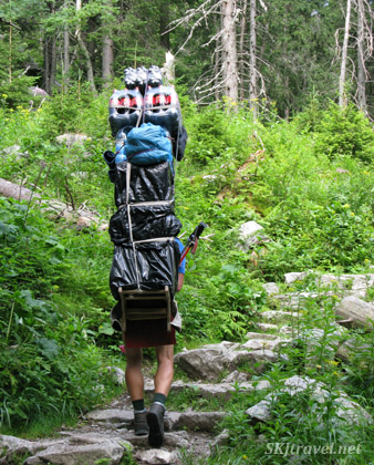 Porter carrying loads of food and drinks up the trail to the chatas in the High Tatras, Slovakia