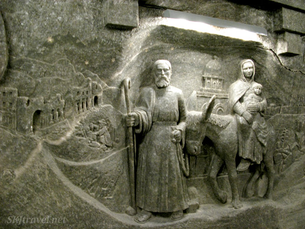 Statues carved into the wall inside the large cathedral in the Wieliczka salt mine. Poland.