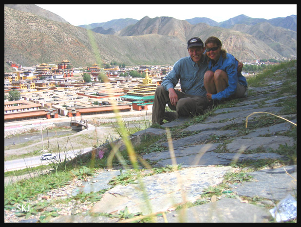 Erik and Shara on a hillside overlooking the Labrang Monastery. Xiahe, China.
