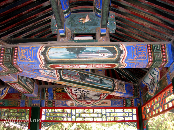 Every beam is completely covered in paintings of geometric designs and framed scenes in the Long Corridor, Summer Palace. China.