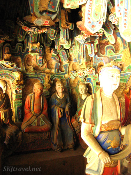 painted figures inside buddhist temple