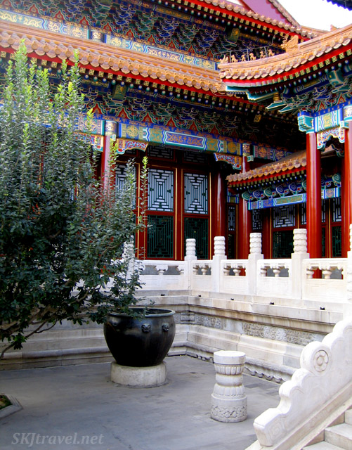 Corner of a courtyard in the Summer Palace with one of the numerous metal pots throughout the grounds. China.
