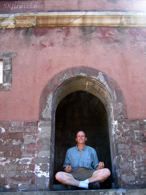 Erik seek enlightenment in an out-of-the-way niche at the Summer Palace. China.