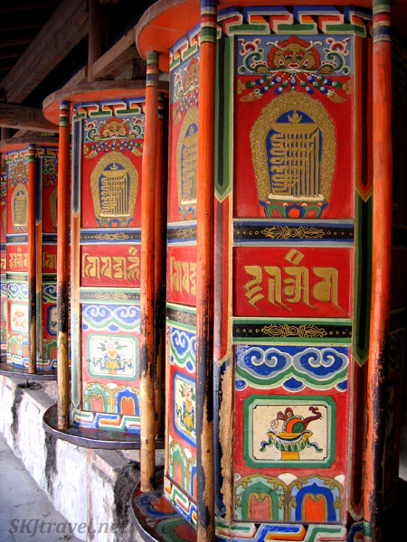 Close-up detail of the painting on the prayers wheels along the Pilgrim's Way at Labrang Monastery, Xiahe, China.