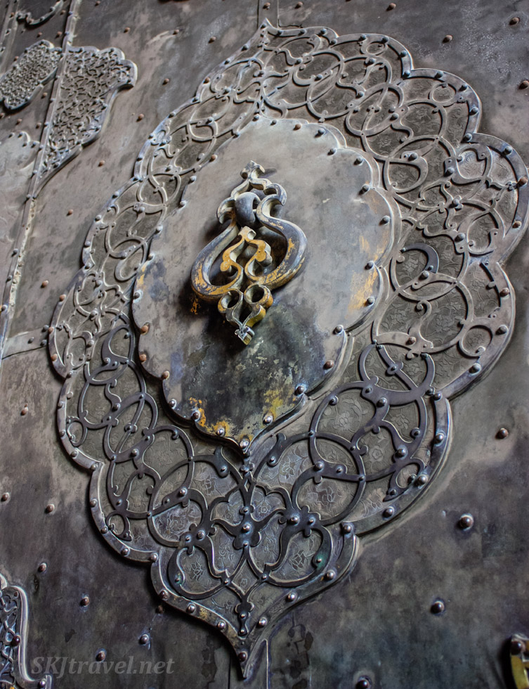 Close-up of door handle on giant metal door to the Imam Mosque, Isfahan, Iran.