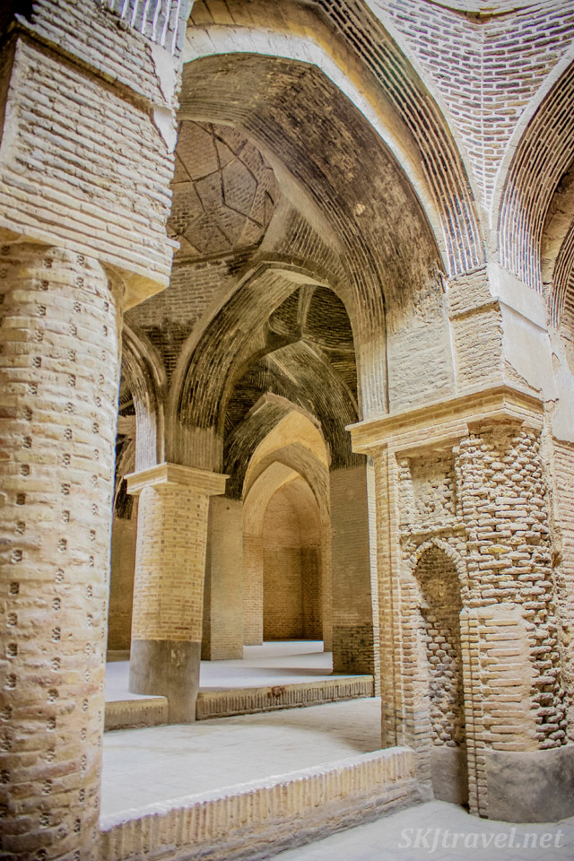 Arched corridors in the old Friday Mosque, Isfahan, Iran.
