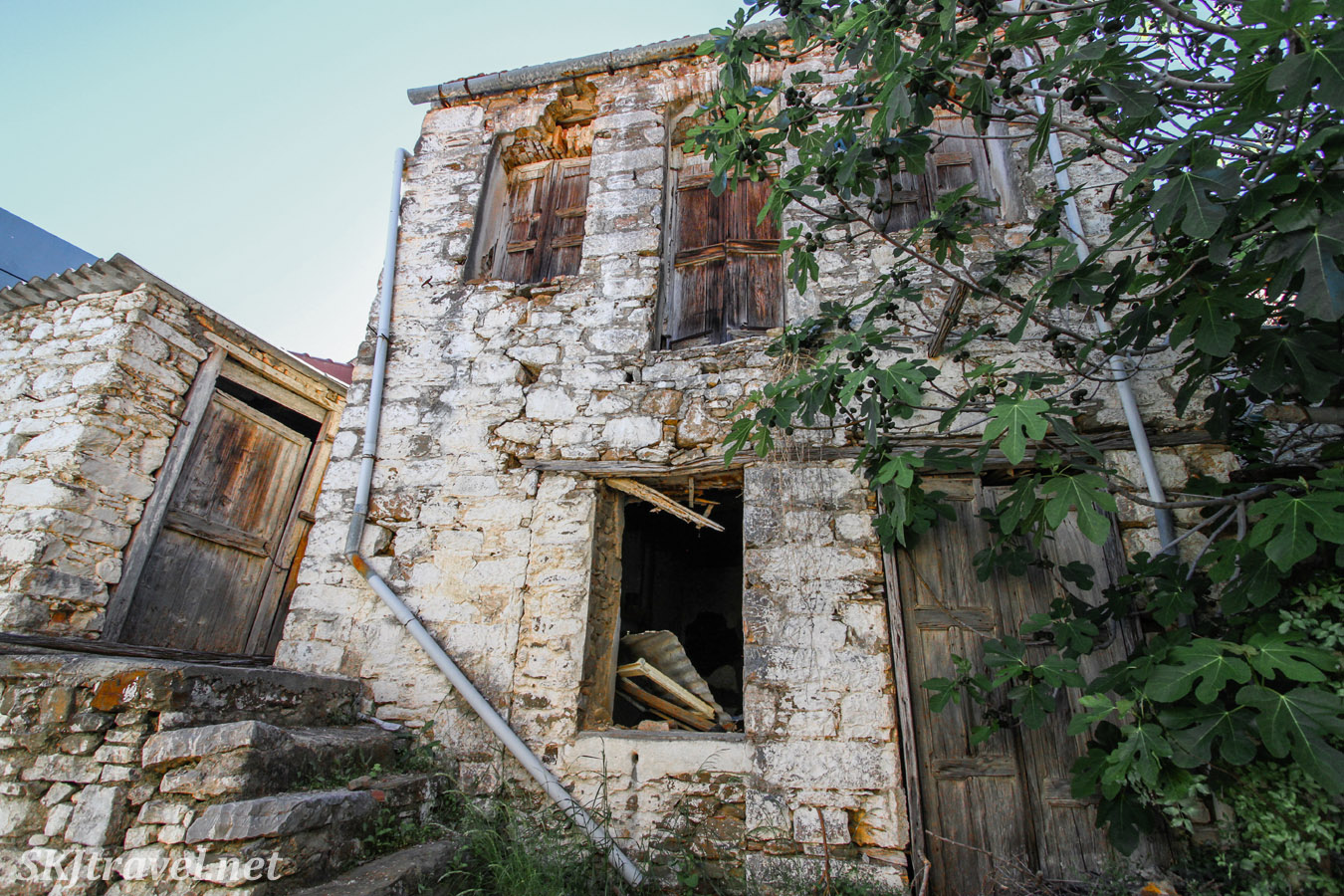 Abandoned stone home being taken over by vines. Volissos, Chios Island, Greece.