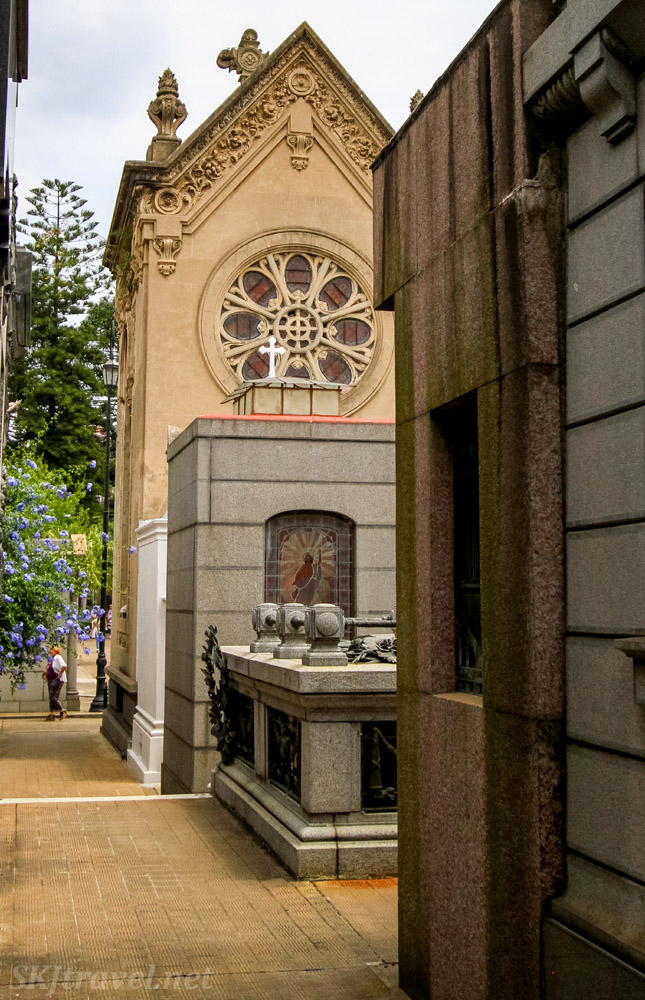 Mausoleum styled like a mini Catholic cathedral with a rose window in Recoleta Cemetery, Buenos Aires, Argentina.