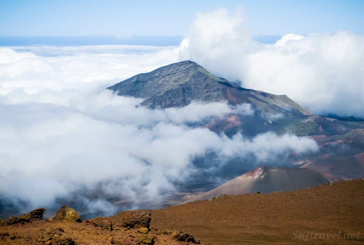 Clouds rising over Haleakala crater like waves crashing against the shore. Maui, Hawaii.