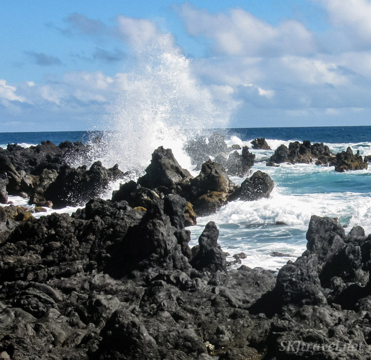 Wave hitting rocks on shoreline at Maui, Hawaii.