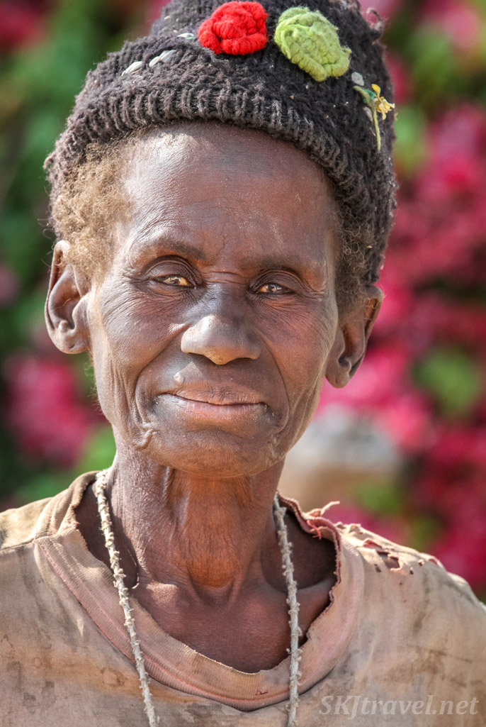 Portrait of an elderly Kavango women coming back to her hut from working in the fields. Namibia.