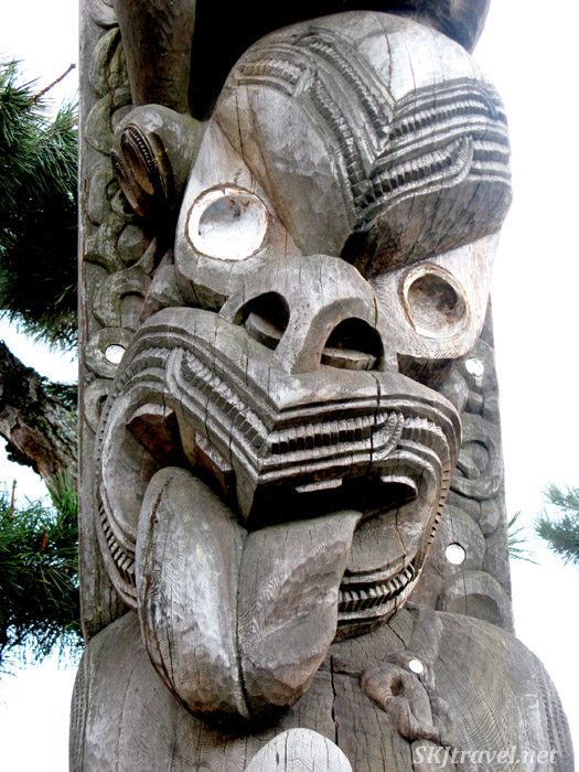 Totem pole, close up of face, Duncan City, British Columbia, Canada.