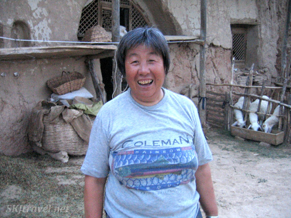 Jolly Old Lady Xiu-Xiu in her courtyard at the rural village of Dang Jiashan, Shaanxi Province, China.