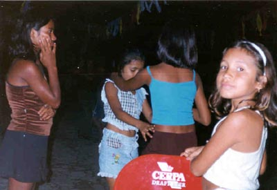 Little girls dancing with each other. Pirabas, Brazil.