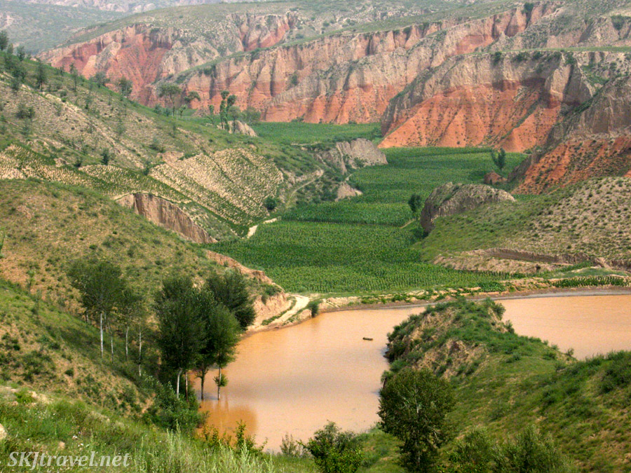 The valley below Dang Jiashan village partially flooded in summer. Shaanxi province, China.