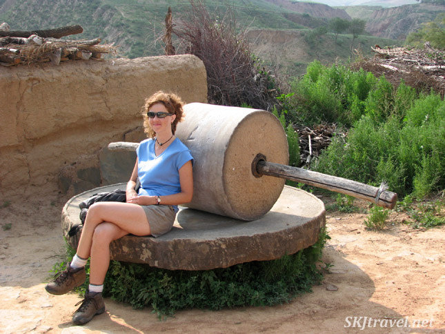Sitting on the stone grinding mill behind the loo (in the daytime, of course). Dang Jia Shan village, northern Shaanxi Province, China.