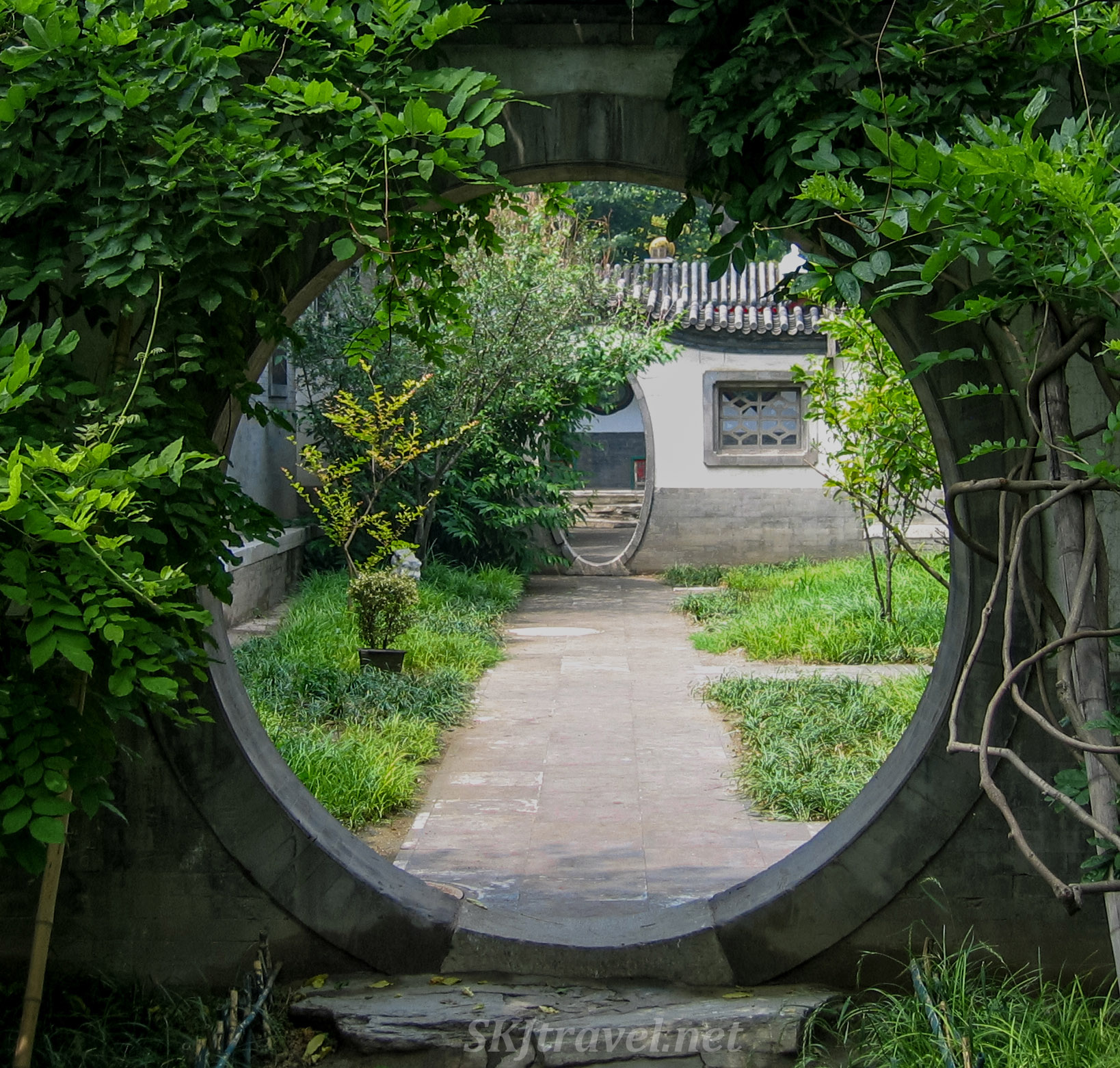 Rounded and oval doorways in a courtyard at Prince Gong's Palace, Beijing, China.