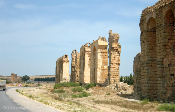 Remains of ancient Roman aqueduct along the highway in Tunisia.