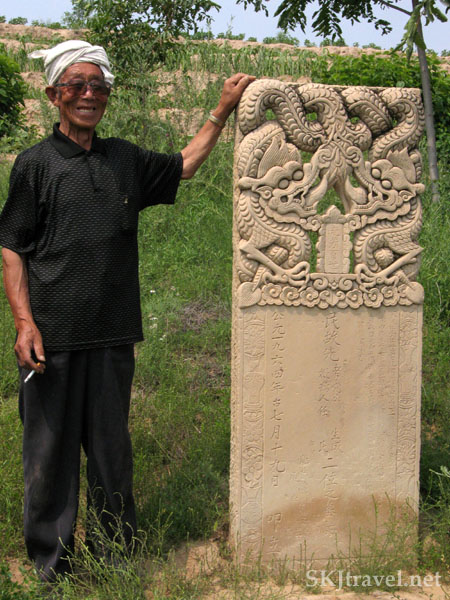 Chinese villager with an elaborate tombstone in a family cemetery in rural China. Photo by Shara Johnson