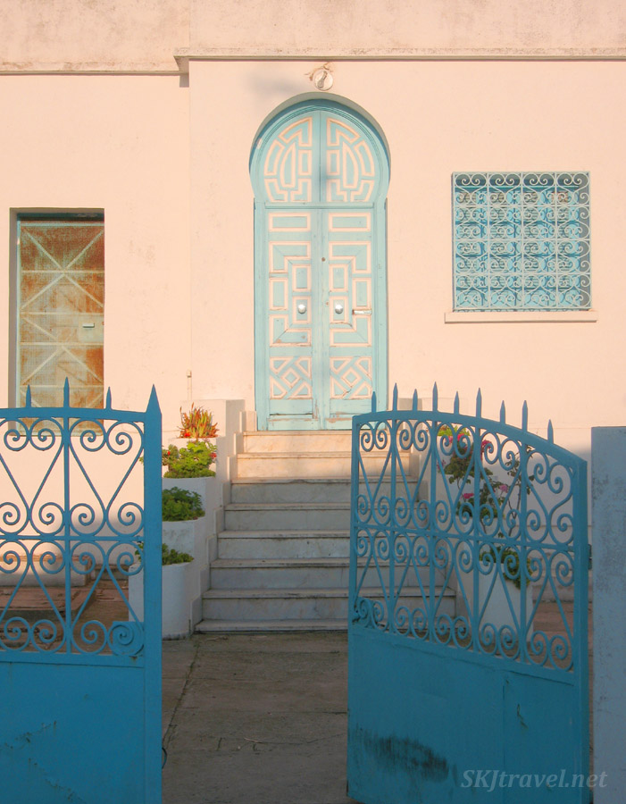 Blue gate to a pink house, street corner in Sidi Bou-Said, Tunisia.