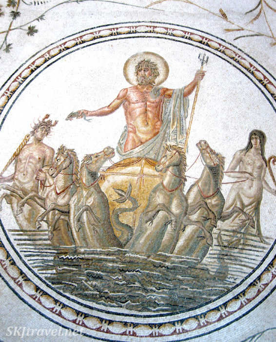 A mythical god in a chariot pulled by horses through the sea ... ancient Roman tile mosaic inside the Bardo Museum, Tunis, Tunisia.