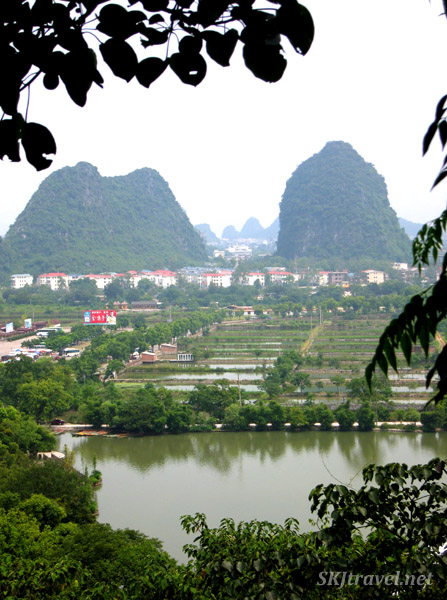 City of Guilin, China. Rice paddies in foreground, karst formations in background.