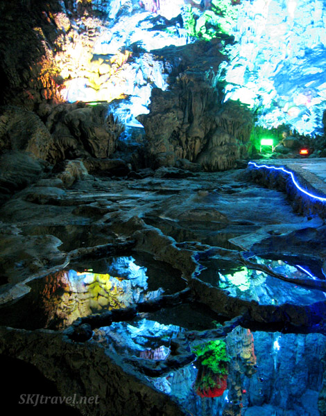 Reflection of cave formations in a pool inside Reed Flute Cave, Guilin, China.