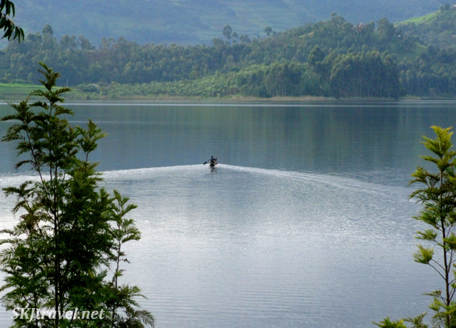 A father canoeing back to his home across Lake Bunyoni, Uganda, after dropping his child off at the primary school.