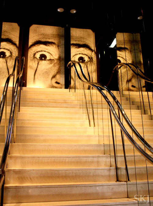 Stairway with Dali's eyes and nose at the top staring down in Figueres. photo by Shara Johnson