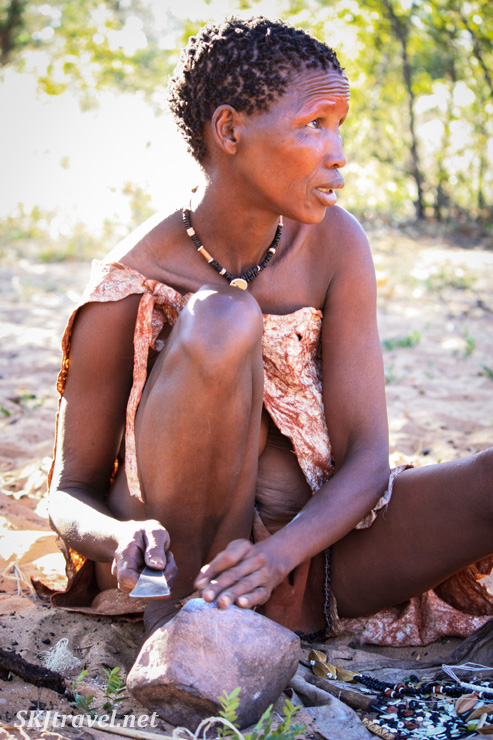 San woman making jewelry at the Ju/'Hoansi-San Living Museum near Grashoek, Namibia.