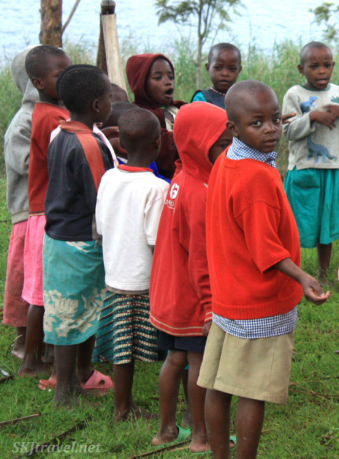 School children singing songs in the morning at Lake Bunyoni, Uganda.