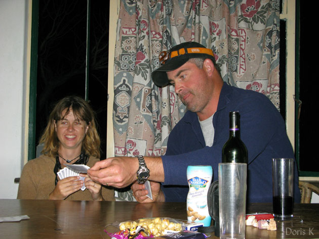 2 people playing cards