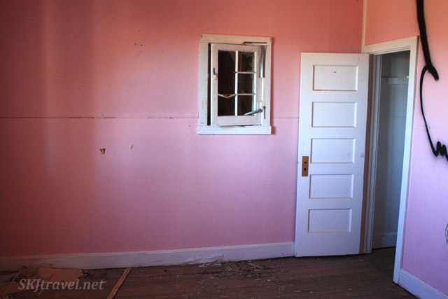 Pink painted room inside an abandoned house in Gilman, Colorado.