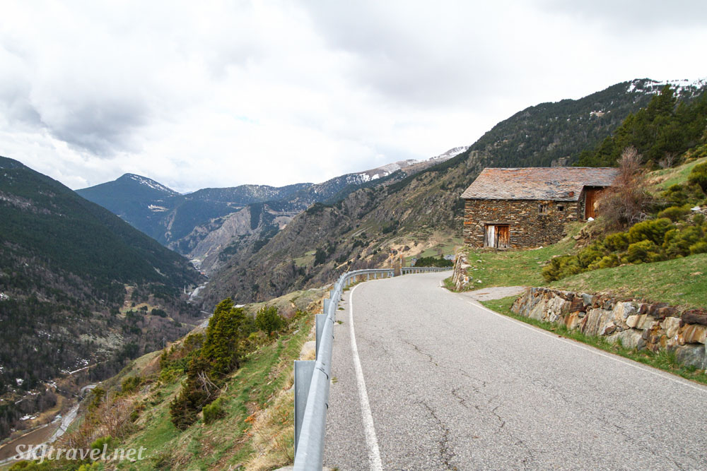 The road above Ransol, Andorra, typical stone farmhouse along the roadside.
