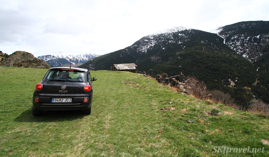 Our rental car on a grassy field as we explore some ruins. Andorra.