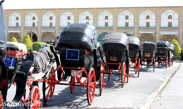 Horse carriages lined up inside the Imam Square, Isfahan, Iran.