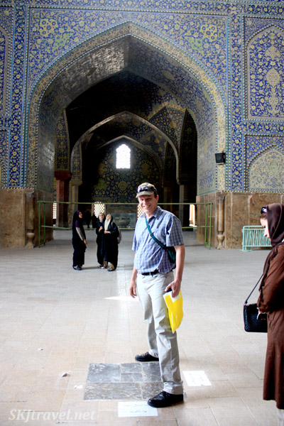 Standing in the middle of the Imam Mosque where you can hear a whisper across the room. Isfahan, Iran.