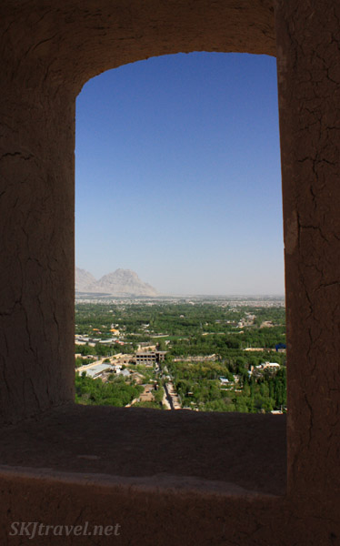 Looking through the window of the round tower at Atashgah down onto the city of Isfahan, Iran.