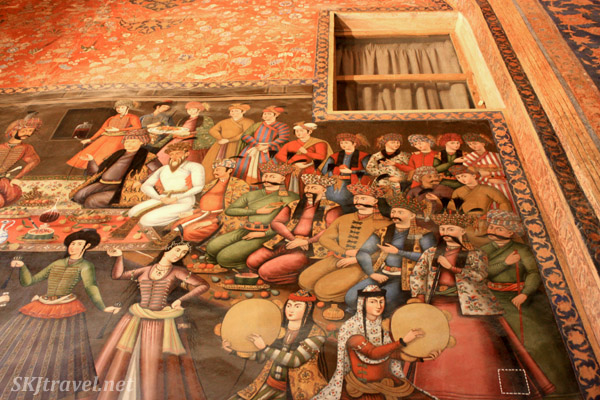 Fresco of an audience gathered to watch dancing entertainment inside Chehel Sutun (forty column palace). Isfahan, Iran.