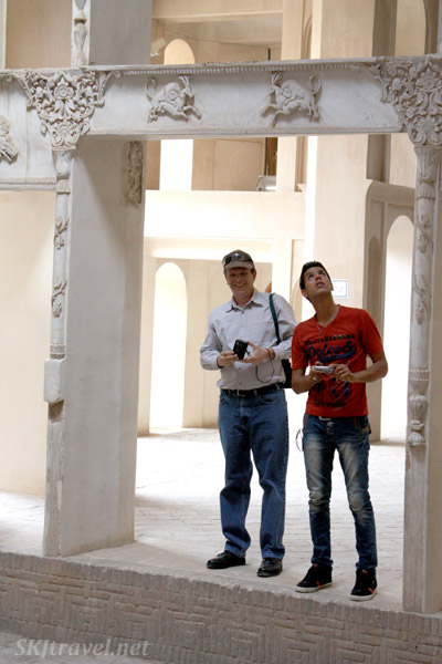 Erik and Reza looking up into the painted ceiling at Borujerdi house in Kashan, Iran.