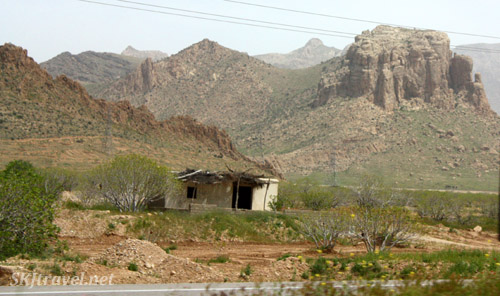 Landscape scenery and small hut along the highway in central Iran.