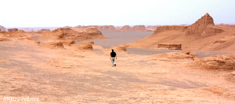 Erik walking through the landscape of the Kaluts natural sand sculptures outside Kerman, Iran.