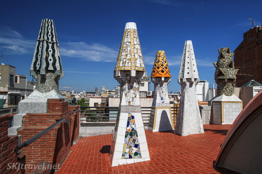 Rooftop sculptures covered in tile mosaics in iconic Gaudi style. Guell Palace / Palau, Barcelona, Spain.