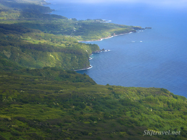 A bird's eye view of the coastline of Maui, Hawaii, from a helicopter.