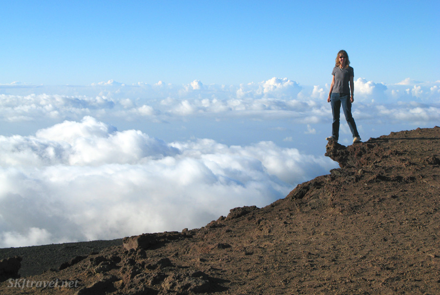 A sea of clouds lies below Shara at the summit of Haleakala volcano, Maui, Hawaii.