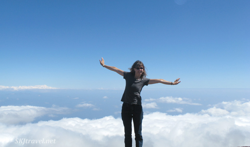 Shara like an airplane, about to fall into the clouds surrounding Haleakala volcano, Maui, Hawaii.