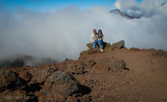 Erik and Shara about to be completely engulfed by a swiftly moving cloud bank inside the caldera of Haleakala volcano, Maui, Hawaii.