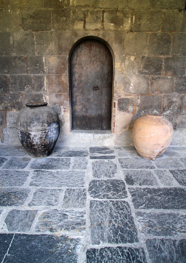 Large jars in cloister corridor at the church of La Seu d'Urgell, Spain.