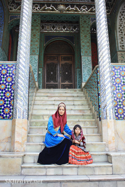 Mother and daughter posing in period costumes at Golestan Palace, Tehran, Iran.